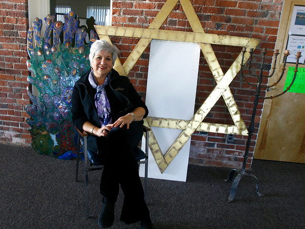 Gloucester: Carole Sharoff, co-president of Temple Ahavat Achim sits with several artifacts that they were able to salvage from the Middle Street fire. On the left is a rendering of the burning bush, center is the Star of David that hung at the top of the temple, and right is a candalabra. Photo by Kate Glass/Gloucester Daily Times Monday, December 8, 2008