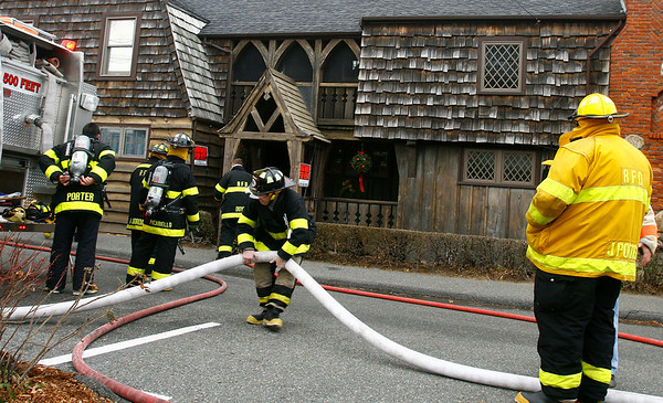 Rockport: Rockport firefighters extinguish a small fire in the basement of 17 Atlantic Avenue yesterday afternoon. The fire was caused by heating tape used to keep pipes warm. No one was injured in the fire. Photo by Kate Glass/Gloucester Daily Times Monday, December 15, 2008