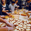 Gloucester: From left to right, Meredith Wilkinson,20, Robbie Harting,14, and C.J. Cracchiolo,13, help prepare Harvest Meals for the community at St. John's Church Tuesday evening. Tiffany Shyu/Gloucester Daily Times