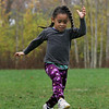 Gloucester: Darcy Muller, 4, of Gloucester kicks a soccer ball after getting a running start at Kettle Cove Field Saturday afternoon.  Darcy was playing soccer with her dad while waiting for her brother to finishing playing with his friends after a youth soccer game. Mary Muckenhoupt/Gloucester Daily Times