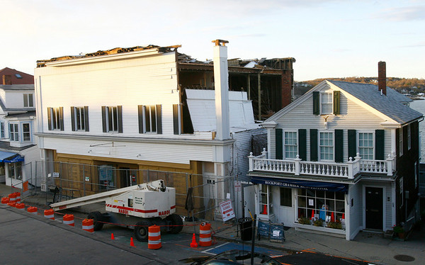 Rockport: The first section of the Haskins building came down Monday afternoon. Photo by Kate Glass/Gloucester Daily Times Monday, November 17, 2008