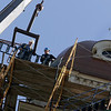 Gloucester: Workers begin removing the scaffolding around City Hall Friday morning.  Mary Muckenhoupt/Gloucester Daily Times
