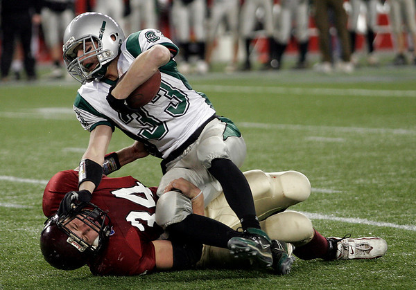 Duxbury's Bobby Murphy gets tripped up by Gloucester's Chris Unis during the Division 2A Super Bowl at Gillette Stadium on Saturday. The Fishermen lost 46-26. Photo by Kate Glass/Gloucester Daily Times Saturday, December 6, 2008