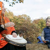 Essex: Andrew Faloon, 2, of Rowley listens to Pumpkinette the Pumpkin Lady sing a song on a hayride out to a pumpkin patch at the Pumpkin Festival Saturday at Cogswell's Grant. Mary Muckenhoupt/Gloucester Daily Times
