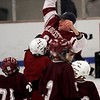 """Gloucester: Gloucester's Ryan Drizen is mobbed by Cape Ann Youth Hockey players as he plays """"keep away"""" with one of their gloves during family night at the Talbot Rink last night. Photo by Kate Glass/Gloucester Daily Times Monday, November 10, 2008"""