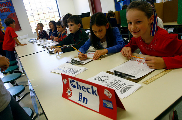 """Rockport: Anna Catena, left, and Jaclyn Connelly, right, both 4th graders, man the check in during Rockport Elementary School's """"Mock Election"""" on Wednesday. Both girls voted for Obama because """"he'd be a great leader and he's younger than McCain."""" Photo by Kate Glass/Gloucester Daily Times Wednesday, October 29, 2008"""