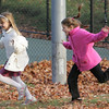 Manchester:  Emily Clark, 8, right ,chases her friend Kiersten Wood, 9, as the two friends play behind Manchester Memorial Elementary School after school was released Wednesday. Mary Muckenhoupt/Gloucester Daily Times
