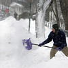 "Manchester: Steve Gang shovels out his driveway on Norwood Avenue Saturday morning.  ""It would be a great day for skiing,"" Gang said, ""but how would you get there."" Mary Muckenhoupt/Gloucester Daily Times"