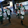 Manchester Essex's Seth Young, Justin Burke, Jake Brown, and Brian Ciccone run through Gillette Stadium to receive their Super Bowl trophy after defeating Tri-County 36-6 on Saturday. Photo by Kate Glass/Gloucester Daily Times Saturday, December 6, 2008