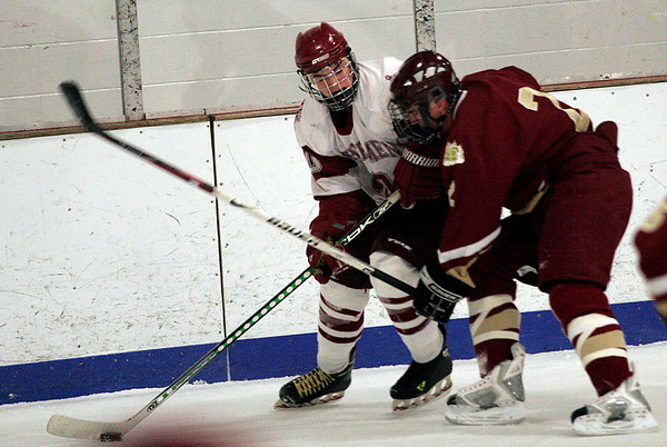 Gloucester: Gloucester's Collyn Rivas skates around Newburyport's Billy Boudreau during their game at the Talbot Rink in Gloucester last night. Photo by Kate Glass/Gloucester Daily Times Tuesday, December 23, 2008