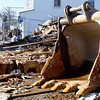 Rockport: Paul Halloran removes debris from Main Street as the Haskins building is demolished yesterday morning. Photo by Kate Glass/Gloucester Daily Times Tuesday, November 18, 2008