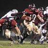 Gloucester:  Gloucester's Gibert Brown gets some good blocking  and heads up field, last night at  Newell Stadium against Lynn English .  Photo by Desi Smith/Gloucester Daily Times Friday, November 7, 2008