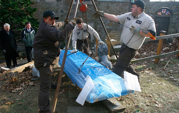 Gloucester: Deacon Churchill, left, Mark Mscisz, center, and Steve Marshall, right, all of North Shore Vault, move a bronze cover for the vault containing the body of John Hays Hammond Jr. through the courtyard after moving his body from the mausoleum to land just outside the Hammond Museum yesterday. Photo by Kate Glass/Gloucester Daily Times Monday, November 24, 2008