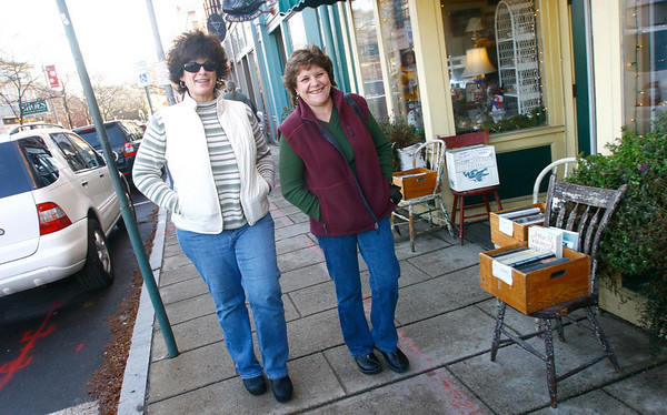 Gloucester: Beth Simpson of Rockport, left, and Karen Ford of Tewksbury stroll down Main Street in Rockport while shopping yesterday afternoon. Photo by Kate Glass/Gloucester Daily Times Monday, December 1, 2008
