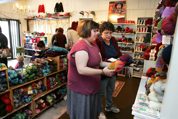 Gloucester: Sarah Bradford, front, helps Joann Clark of Gloucester find the right type of yarn at Coveted Yarn, a new knitting shop in East Gloucester. Mary Muckenhoupt/Gloucester Daily Times