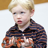 Gloucester: Deston Cauthers, 3, of Gloucesters looks up at Rick Roth after Roth handed him a Sinaloan milk snake at Sawyer Free Library.  Rick Roth of the Cape Ann Vernal Pond Team presented Snakes of Massachusetts and the World for children of all ages at the library Saturday morning. Mary Muckenhoupt/Gloucester Daily Times