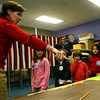 Rockport: Mrs. Trumbour shows her first and second grade students, Jenna Horn, Kasey Smith, Julia Moceri, and Valerie Wise, the process of voting as Rockport residents cast their ballot on whether the town should purchase the Granite Savings Bank at 42 Broadway. Photo by Kate Glass/Gloucester Daily Times Tuesday, November 25, 2008