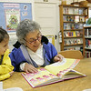 Essex: Ann Coccolutoof Manchester reads a Dr, Suess book to her granddaughter Sarah Braimon, 4, of Essex during Grandparents Day at TOHP Burnham Essex: Ann Coccoluto of Manchester reads a Dr. Suess book to her granddaughter Sarah Braimon during Grandparents Day at TOHP Burnham Library Saturday morning.  The library held the day so that grandparents could come and read a story with their grandchildren and enjoy some baked goods and receive a special recognition award. Mary Muckenhoupt/Gloucester Daily Times
