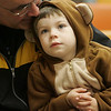 Gloucester: Stefano Adelfio, 2, sits on his dad's lap while listening to story teller Lucille LePage at the Sawyer Free Library Friday morning. LePage's program was called Halloween with a Heart, and told the kids Halloween stories that were more funny then scary. Mary Muckenhoupt/Gloucester Daily Times.