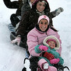 Gloucester: Nicole Gardner, 3, of Gloucester takes a sled ride with, front to back, Rebecca Linquatta, Arianna Sanfilippo, Michelle Aiello and TŽa Ryder at Stage Fort Park Saturday afternoon.  This was Nicole's last ride down before heading home with mom to get warm. Mary Muckenhoupt/Gloucester Daily Times