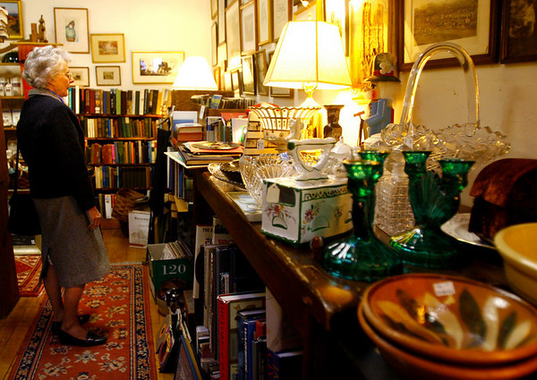 Gloucester: Gwendolyn Carr of Magnolia shops at Main Street Arts & Antiques. Although she did not buy any gifts yesterday, she says she likes to browse the antique shops every now and then. Photo by Kate Glass/Gloucester Daily Times Monday, December 1, 2008