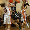Ipswich: Manchester Essex's Lee Stroman tries to shoot around Beverly's Meghan Chatellier during the finals of the Institution for Savings 2008 Invitational at Ipswich High School last night. Photo by Kate Glass/Gloucester Daily Times Tuesday, December 30, 2008