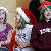Essex: Elizabeth Hull, Holly Fossa, and Ashley Dort, all third graders at Essex Elementary School, laugh as a student performs a funny rap during the school's hidden talents spirit day on Monday. Photo by Kate Glass/Gloucester Daily Times Monday, December 8, 2008