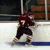 Gloucester: Newburyport's Gaen LaValley checks Gloucester's Josh Salah into the boards during the first period of their game last night. Photo by Kate Glass/Gloucester Daily Times Tuesday, December 23, 2008