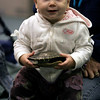 Gloucester: Anna Kercher, 1, smiles as she holds a turtle shell during an Audubon presentation on animal habitats at the Sawyer Free Library on Monday. The children saw a turtle, skunk and hawk. Photo by Kate Glass/Gloucester Daily Times Monday, November 10, 2008