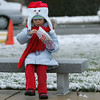 Gloucester: Maya Acker, 7, enjoys some freshly popped popcorn while waiting for the Santa parade to arrive at Kent Circle Sunday afternoon.  Mary Muckenhoupt/Gloucester Daily Times