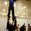Gloucester: Gloucester cheerleading coach Eric Bichao lifts Gloucester running back Ross Carlson as they prepare for their pep rally, which will be held on Wednesday. The Gloucester cheerleaders recently won a state championship and the football team is already looking ahead to the playoffs. Photo by Kate Glass/Gloucester Daily Times Monday November, 24, 2008