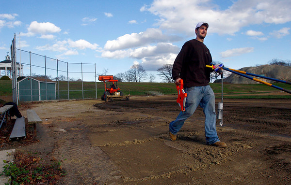 "Gloucester: Corey Frost, right, helps Jeff Davis, owner of Home Field Athletics, prepare to resod the Salvatore ""Sammy"" Parisi Field at Stage Fort Park yesterday in preparation for the winter months. Temperatures are expected to drop below freezing tonight with a slight chance of rain or snow showers. Photo by Kate Glass/Gloucester Daily Times Monday, November 17, 2008"