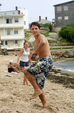 Gloucester: Mark Horgan, 14, of Gloucester pitches the wiffle ball at his cousin as they play a game on Pavilion Beach, Monday. Photo by Ceci Guillen/Gloucester Daily Times Monday July 21, 2008.