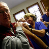 Rockport: Sally Brown, who recently retired from her post as Rockport High School's nurse, gives Bob Burbank a flu shot at the Rockport Methodist Church yesterday afternoon. The clinic, offering flu shots for seniors was sponsored by the Council on Aging. Photo by Kate Glass/Gloucester Daily Times Wednesday, November 5, 2008