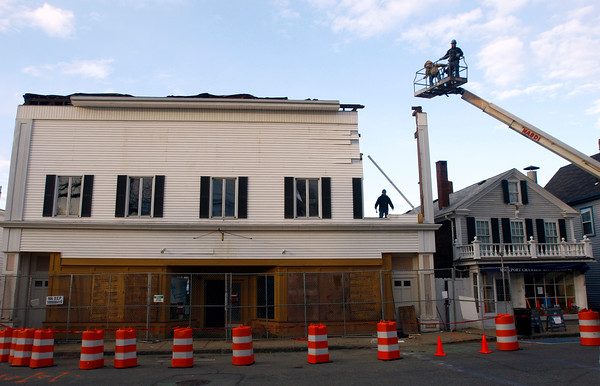 Rockport: The demo crew takes down the first section of the Haskins building on Monday in preparation for the full job on Tuesday. Photo by Kate Glass/Gloucester Daily Times Monday, November 17, 2008