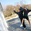 Manchester: Justin Swansburg, 16, and Andy Swansburg, 15, play a version of wall ball off the Major Sands Beachcomber Cafe at Singing Beach yesterday. The two threw a tennis ball on the roof and then raced to see who could catch it first. Photo by Kate Glass/Gloucester Daily Times Wednesday, December 3, 2008