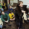 Gloucester: Andrew Murdock, a forth grader at Eastern Point Day School, wears an authentic bear skin as Dan Cripps of Native American Perspectives talks about how Native Americans wore animal skins as coats to keep them warm and dry.  Cripps came to the school on Saturday to teach the children about Native Americans before their big field trip to Plimoth Plantation next week.  Mary Muckenhoupt/Gloucester Daily Times