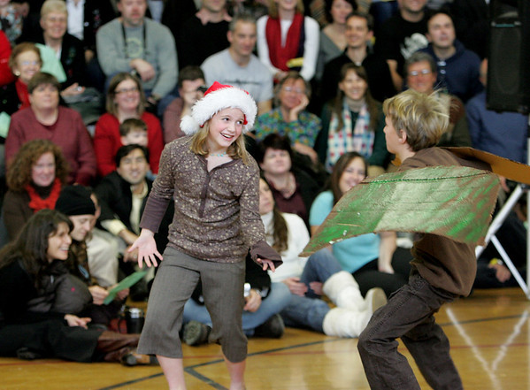 Manchester: Forth graders Avery Shaw and William Heslop perform during the holiday concert at Manchester Memorial Elementary School Friday afternoon.  William was playing a turkey as the chorus sang a song about a turkey following someone home and for the concert that someone was Avery. Mary Muckenhoupt/Gloucester Daily Times.