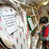 Rockport: Sam Dusman, 12, enters his name into the raffle for the giant candy cane at Tucks Candy in Dock Square Friday afternoon.  The winner of the 6 foot candy cane will be announced December 20.  Mary Muckenhoupt/Gloucester Daily Times