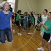Manchester: Avery Shaw, 9, learns how to double dutch jupm rope as the Beantown Jumpers, a double dutch team from Jamaica Plain, performed at the First Parish Chapel Saturday morning.  The jumpers gave a presentation and answered questions before teaching the kids how to double ducth. Mary Muckenhoupt/Gloucester Daily Times.