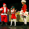 "Gloucester: Erik Anderson as Santa Claus and Jane Grady as Mrs. Claus listen to Sara Wheeler as Rudy the Candy Maker explain how candy got stuck on her during Eastern Point Day School's performance of ""Holidays around the World"" at the Gloucester Stage Company on Monday night. The children performed a scene from Hanukkah, Kwanzaa, and Christmas. Photo by Kate Glass/Gloucester Daily Times Tuesday, December  16, 2008"