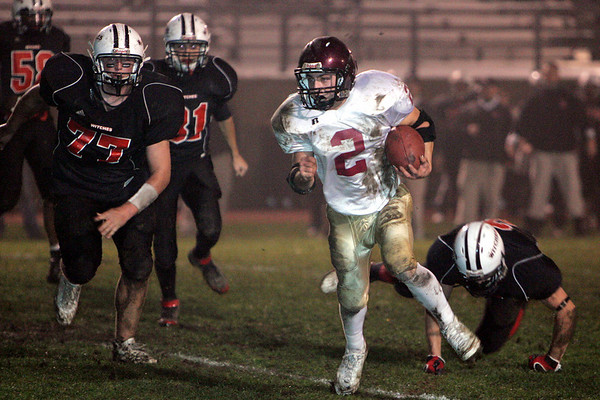 Gloucester: Gloucester's Ross Carlson runs for a touchdown during the Gloucester vs. Salem football game at Bertram Field Friday night. Mary Muckenhoupt/Gloucester Daily Time