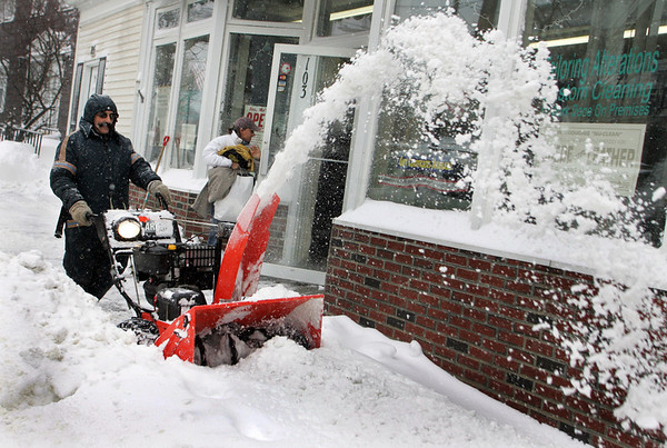 Gloucester: Rosario Maletti, owner of DeMarcoCleaners on Washington Street clears the sidewalk in front of his business Saturday afternoon. Mary Muckenhoupt/Gloucester Daily Times