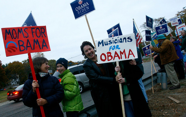 Gloucester: Laura Furber, left, and her daughter, Alyssa, 11, join Hope Norton and Cordelia Horowitz, 16, at Grant Circle on Monday evening along with dozens of people who turned out to show their support for candidates, both local and national. Photo by Kate Glass/Gloucester Daily Times Monday, November 3, 2008
