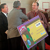 "Rockport: Dave Kenney, left, store director of the East Gloucester Shaw's, and Charlie Fernandes, center, a representative of General Mills, congratulate Rockport Elementary School Principal Shawn Maguire as they announce that the school won the ""Shaw's Back to School Bonus Box Tops Challenge."" The school received $50,000, which will be used to improve school activities and facilities, including computer advancements. Photo by Kate Glass/Gloucester Daily Times Tuesday, November 17, 2008"