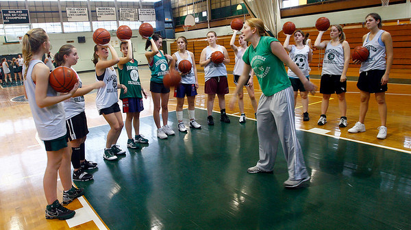 Manchester: Manchester Essex girls basketball coach Lauren Dubois goes over a shooting drill with the team yesterday afternoon. The Hornets are looking to get to the state finals again this year. Photo by Kate Glass/Gloucester Daily Times Monday, December 15, 2008