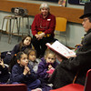 "Gloucester: Kidergarten students from St. Ann School listen  to Charlie Vogel read ""How the Grinch Stole Christmas"" At Sawyer Free Library Thursday morning. The kidergarten class of St. Ann School came down to the library to listen to Vogel read them a story and to sing Christmas carols. Mary Muckenhoupt/Gloucester Daily Times."