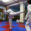 Gloucester: Andie-Jane Phinney, 13, spars with Philip Hubbell, 15, at Demetris Taekwondo in Gloucester. The two recently traveled to Detroit for a national taekwondo competition. Photo by Katie McMahon/Gloucester Daily Times Wednesday, July 9, 2008