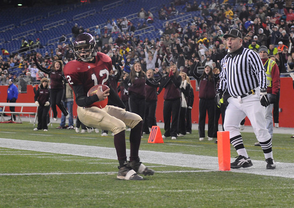 Gloucester's Taylor Burbine crosses the goal line for a touch down against Duxbury High School for the Division 2A Superbowl game at Gillette Stadium in Foxboro,Mass Saturday night December 6,2008