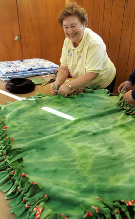 Rockport: Joanne Wile laughs with Judi Harris as they make a knots of love throw at the Circle Center in Pigeon Cove Saturday afternoon.  These fleece throws are just some of the homemade items that will be sold at the Holiday Fair held at the Circle Center Saturday Nov. 29. Mary Muckenhoupt/Gloucester Daily Times